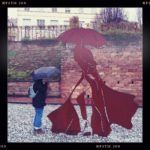Umbrella Woman and Metal Sculpture in Bitche/France
