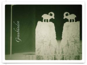 Röntgenbildähnliche Szene mit zwei Steinböcken, darauf der Schriftzug Graubünden, verfremdetes inversbild.