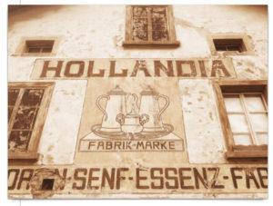 Sepiafarbene Hausbemalung als Werbung für Hollandia Senf-Essenz. Vintage-Look