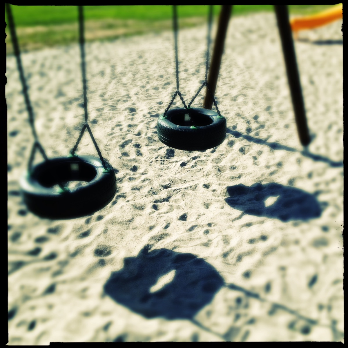 Two swings made of old tires